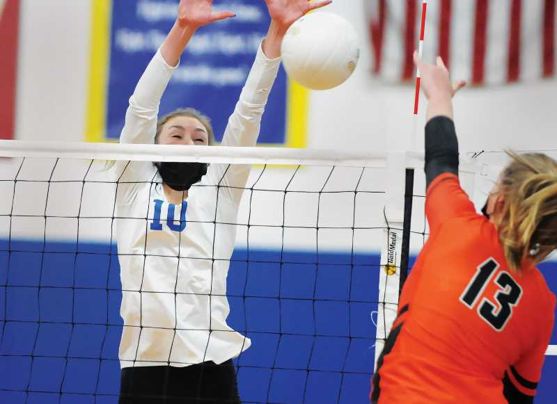 PMG FILE PHOTO - The NHS Tigers earned a three-set victory over Liberty on Thursday evening, raising their conference record to 2-1.