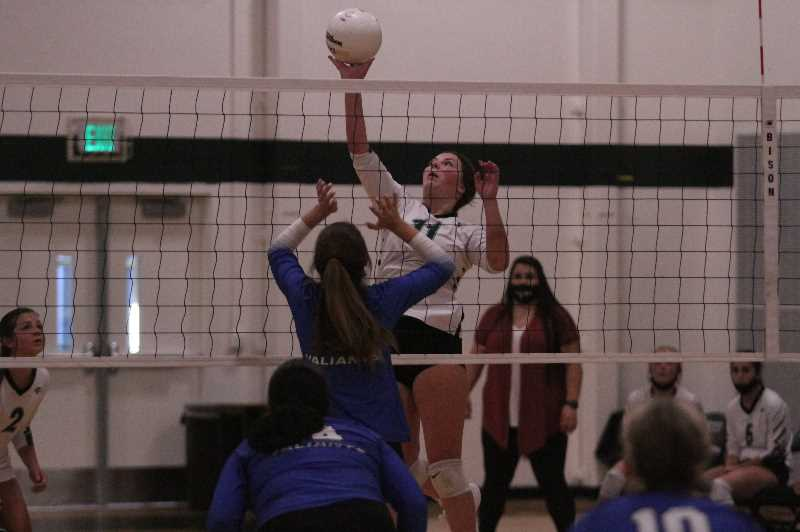 PMG PHOTO: TANNER RUSS - North Marion junior Shay Coello goes up for a kill against the Valley Catholic Valiants.