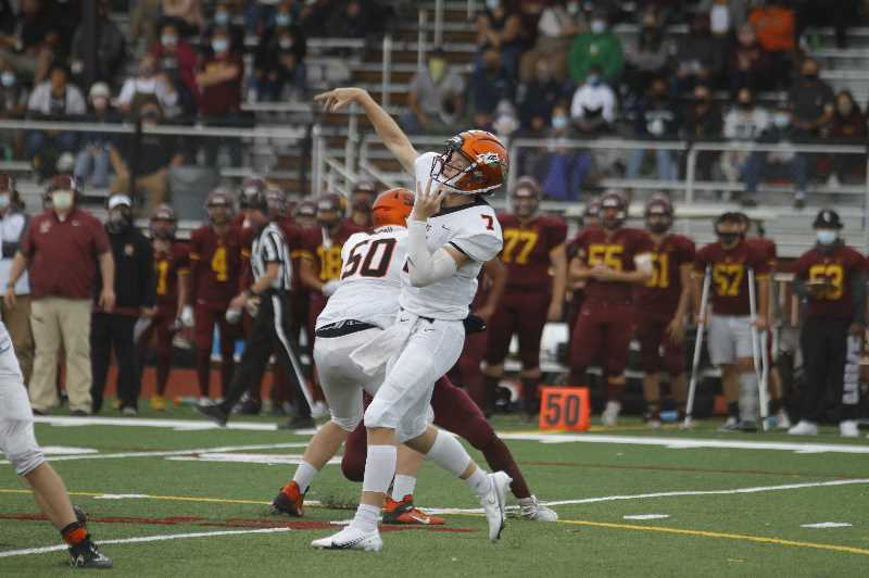 PMG PHOTO: WADE EVANSON - Scappoose quarterback Luke McNabb throws a pass during the Indians' 35-6 win over Forest Grove Saturday, Sept. 18, at Forest Grove High School.