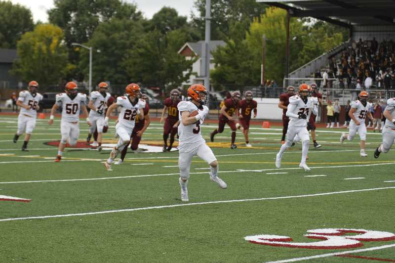 PMG PHOTO: WADE EVANSON - Scappoose senior receiver Colin Stoddard runs towards the end zone during the Indians' 35-6 win over Forest Grove Saturday, Sept. 18, at Forest Grove High School. Stoddard caught 11 passes for 165 yards and three touchdowns in the game.