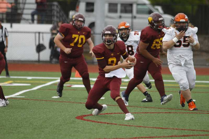 PMG PHOTO: WADE EVANSON - Forest Grove quarterback Kaden Hale runs from the Scappoose defense during the Vikings' game against the Indians Saturday, Sept. 18, at Forest Grove High School.