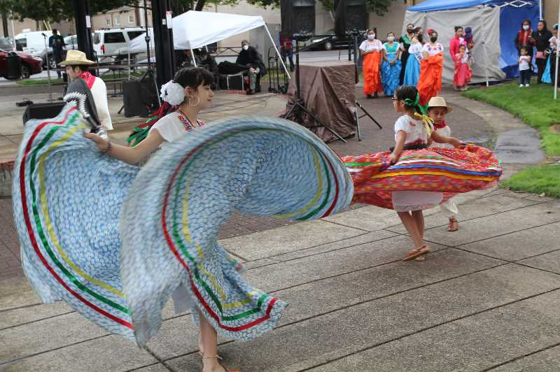 PMG PHOTO: JUSTIN MUCH - Dancing kicked off the cultural festivities for Woodburn's Hispanic Heritage celebration Saturday, Sept. 18.