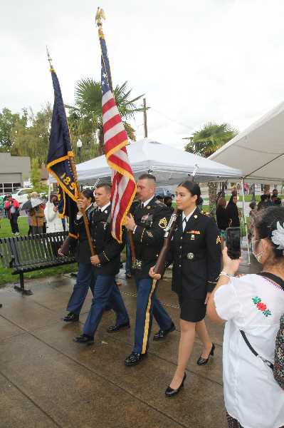 PMG PHOTO: JUSTIN MUCH - The Oregon National Guard color guard made an appearance at Woodburn's Hispanic Heritage celebration Saturday, Sept. 18.