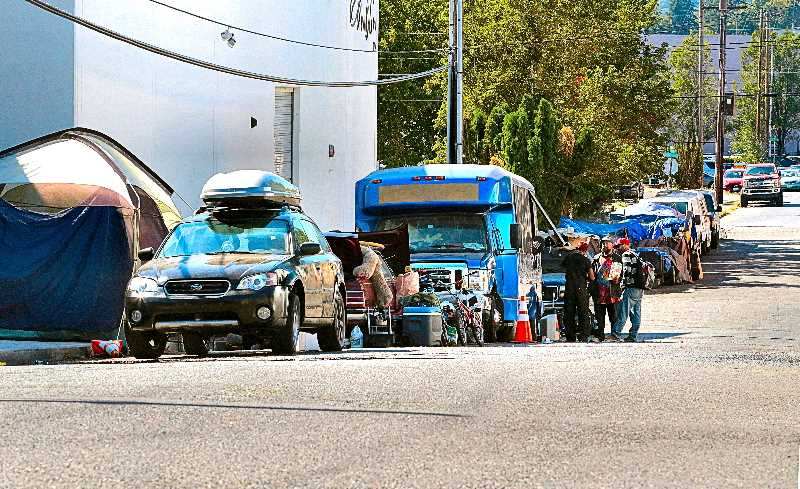 DAVID F. ASHTON - Several neighbors tell THE BEE that they believe this transient encampment may hide an Inner Southeast Portland car chop-shop.