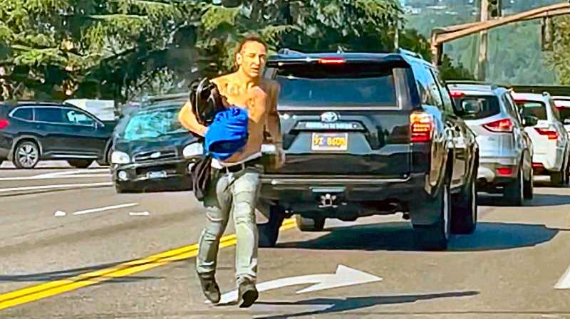COURTESY KOIN-TV-6 NEWS - If you recognize this man - allegedly the driver who walked away from a hit-run accident that killed a pedestrian, at McLoughlin and Holgate Boulevards - please let the police know immediately.