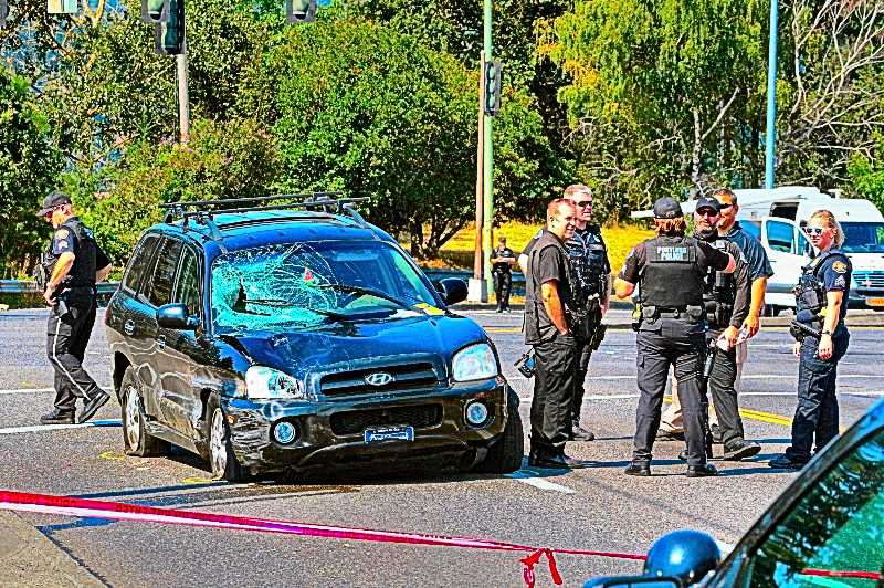 DAVID F. ASHTON - Investigators from the Portland Police Bureaus Major Crash Team here were looking over the Hyundai; the victims body dented its fender, and smashed into its windshield. The crash was fatal to the person struck; but the driver just got out of the car, and walked away without a shirt.