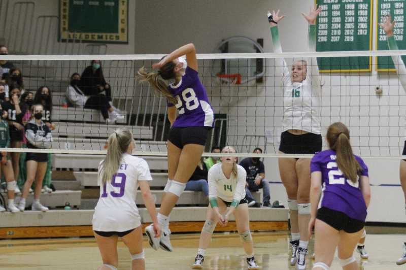 PMG PHOTO: WADE EVANSON - Sunset's Sara Davies attacks the net against Jesuit senior Tess Masingale. The Crusaders defeated the Apollos in straight sets Thursday, Sept. 16, at Jesuit High School.