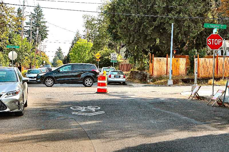 DAVID F. ASHTON - Look for contractors to be measuring, marking, and eventually building a new water main along S.E. 19th Avenue; it will cross under this intersection at Tacoma Street.
