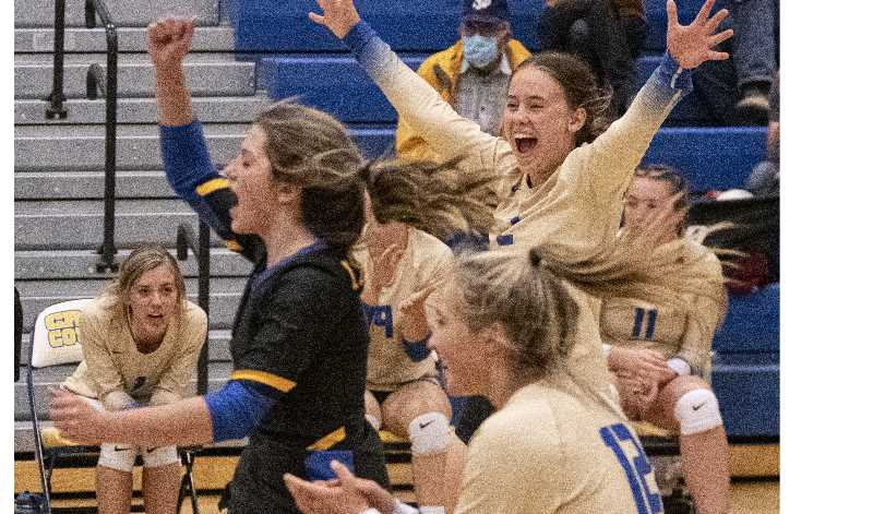 LON AUSTIN/CENTRAL OREGONIAN - Crook County players Alexys Wells, Jenny McKinnon and Danner Hemphill celebrate during their four-set win over The Dalles.