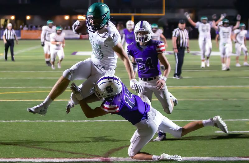COURTESY PHOTO: BRAD CANTOR - West Linn sophomore Gus Donnergerg leaps into the end zone to score during his team's 28-14 non-league win over Sunset at Sunset High School on Friday, Sept. 17.