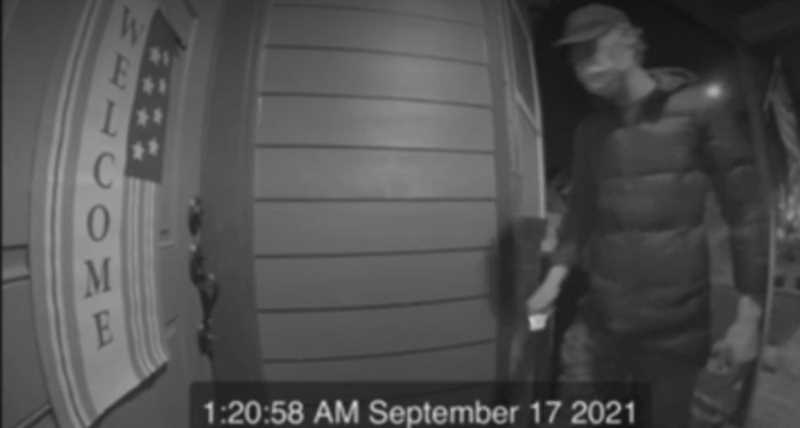 COURTESY PHOTO: OCPD - A surveillance video shows a man pulling out a burglary tool at a house near Hampton Drive and Pease Road in Oregon City.