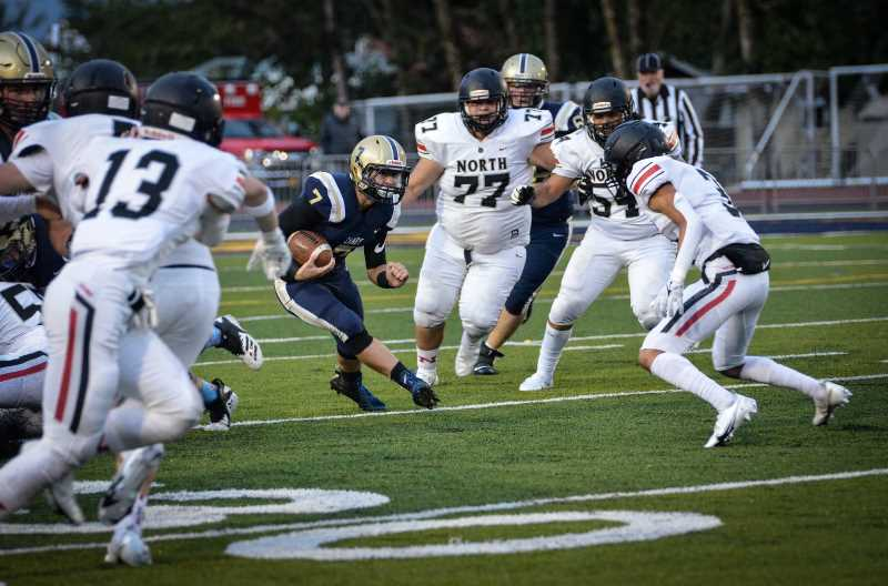 COURTESY PHOTO: SARAH OLIVER - Senior running back Bryce Oliver dodges North Salem defenders. He scored three touchdowns in a blow-out victory over the Vikings Saturday, Sept. 18.