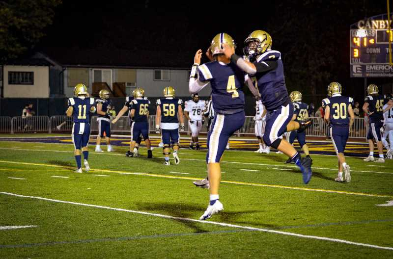 COURTESY PHOTO: SARAH OLIVER - Mikey Gibson and Bryce Oliver celebrate a touchdown in a big league win over North Salem Saturday.