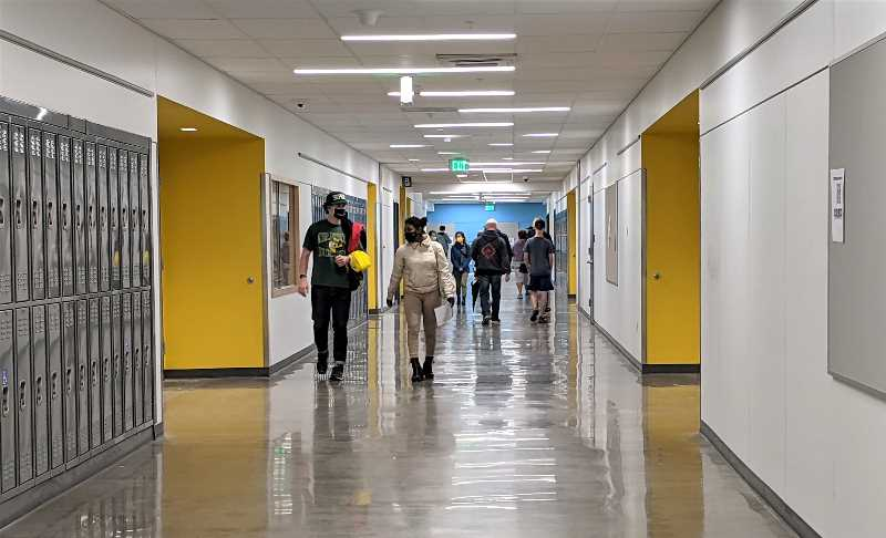 PMG PHOTO: COURTNEY VAUGHN - Students and members of the public tour the newly remodeled Leodis V. McDaniel High School during a grand opening ceremony Sept. 18.