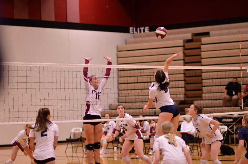COURTESY PHOTO: SARAH OLIVER - Chloe Annas jumps for a kill versus Tualatin. Annas was Canby's leading scorer during the tournament over the weekend.