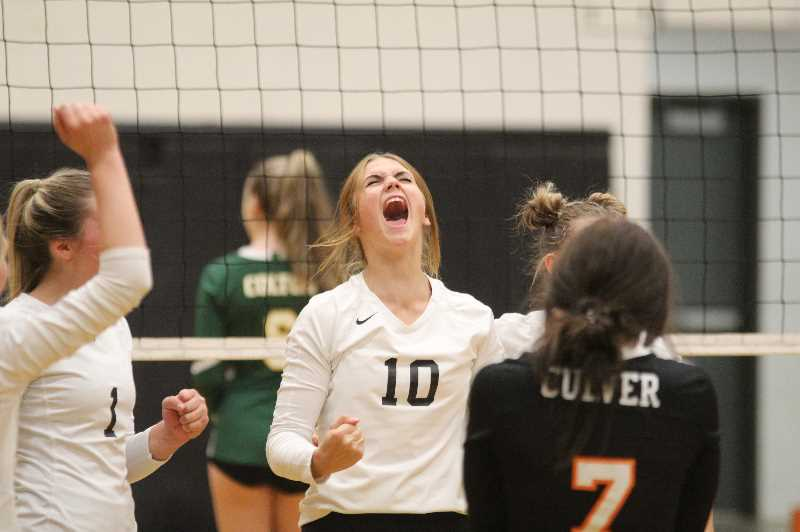 ANDY DIECKHOFF/MADRAS PIONEER - Culver junior Hensley Wachter (10) celebrates one of her many kills during the Bulldogs' three-set victory over Colton on Monday night.