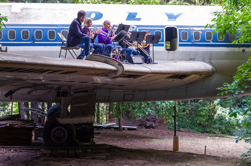 PMG PHOTO: DIEGO G. DIAZ - The Portlandia Brass Ensemble performed Sunday, Sept. 5, on top of the wing of a decommissioned Boeing 727 jetliner turned into a home, the Boeing House, near Laurel.