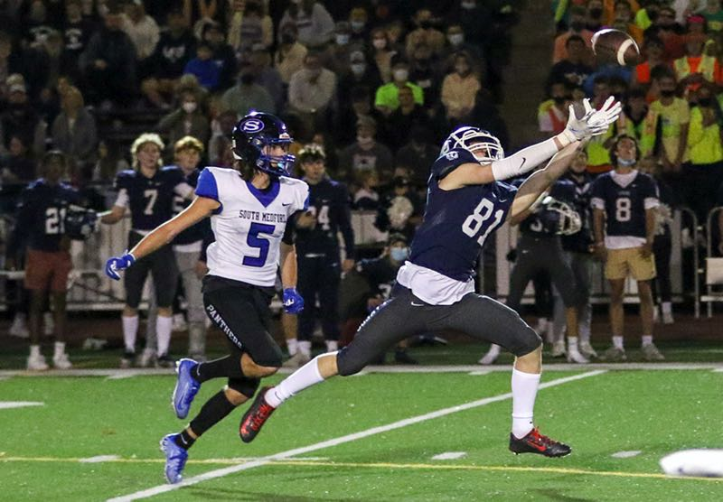 COURTESY PHOTO: KEN TAYLOR - Lake Oswego junior Owen West stretches to try and make a catch during his team's 41-14 win over South Medford at Lake Oswego High School on Friday, Sept. 17.