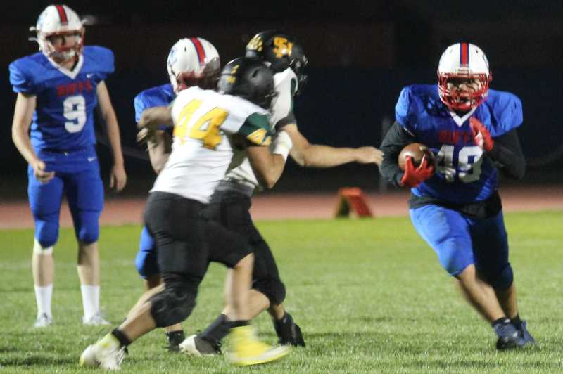 ANDY DIECKHOFF/MADRAS PIONEER - Madras running backs Skytus Smith, pictured, and Johan Poland combined for 92 yards on 21 carries. 'Johan is the slash-and-dash,' said head coach Kurt Taylor. 'Skytus is the ground-and-pound.'