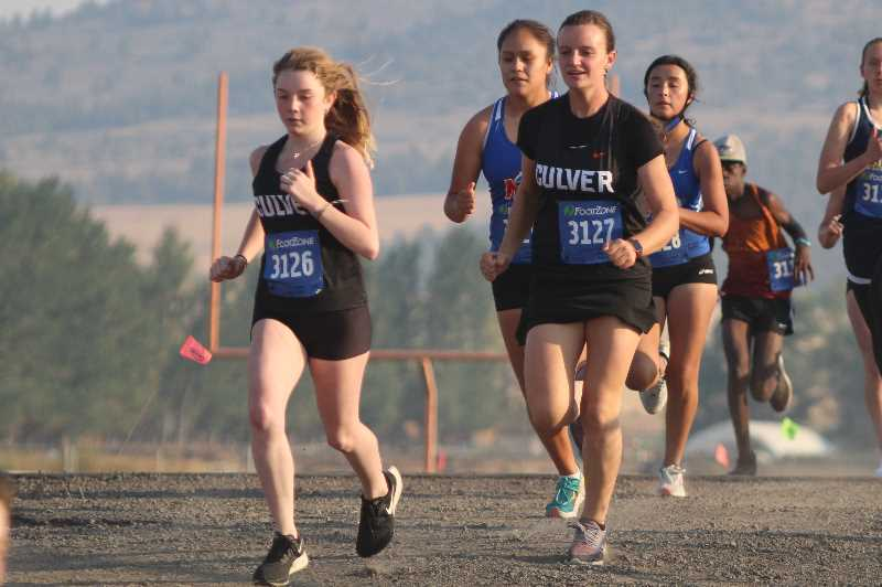 ANDY DIECKHOFF/MADRAS PIONEER - Culver runners Audry Rake, left, and Olivia Rydman are two of the strongest runners in the program, despite this being the first time either has run for a high school team.