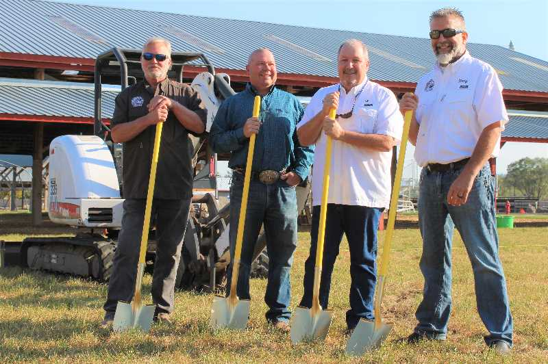PAT KRUIS/  MADRAS PIONEER  - The Jefferson County Fair Board members, from left, Kent Cook, Chuck Patterson, Al Short and Terry Weitman, wield their golden shovels to break ground on the fair's new show barn. The $375,000 project is fully funded by sponsors and partners.
