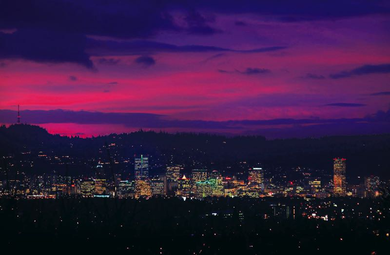 FILE - The Portland skyline lights up the night in 2013.