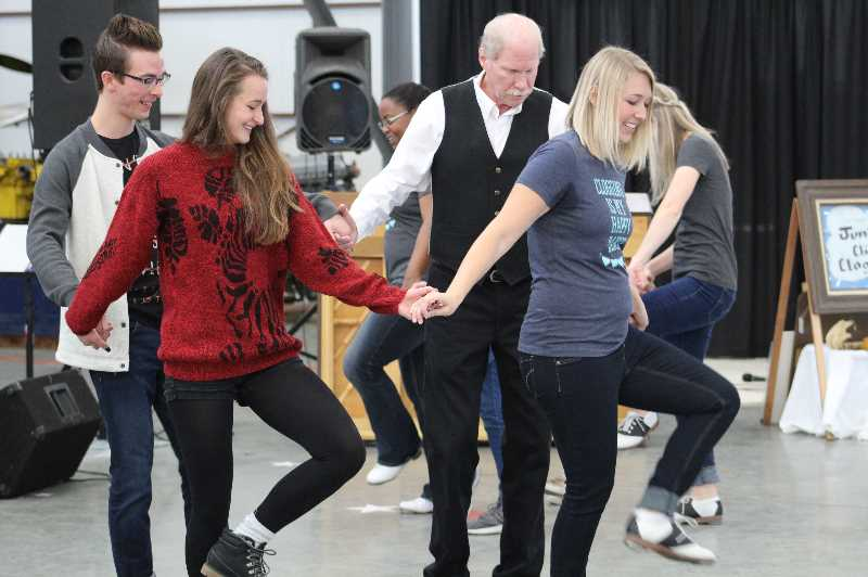PIONEER ARCHIVES   - The Juniper Clickin' Cloggers invited the audience to join them for a dance during the 2019 Air Time Music Festival, which returns to Madras Friday and Saturday, Oct. 1-2 at the Erickson's Aircraft Collection Hangar.