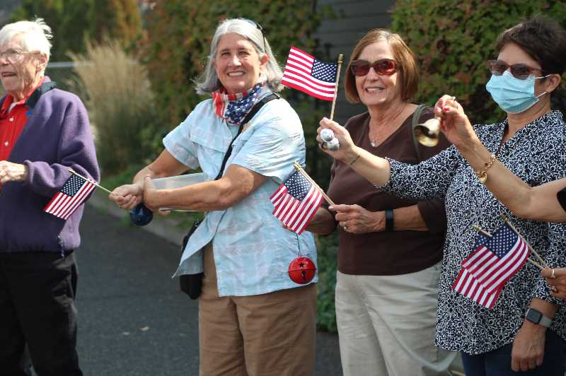 ANDY DIECKHOFF/MADRAS PIONEER   - Pictured left to right: Daughters of the American Revolution member Mary Rueter, of Madras; DAR member Terry Dittman; Kay Wiles, of Madras; and Christin Peterson, of Madras, wave flags and ring bells during the Daughters of the American Revolution bell-ringing ceremony Friday, Sept. 17.
