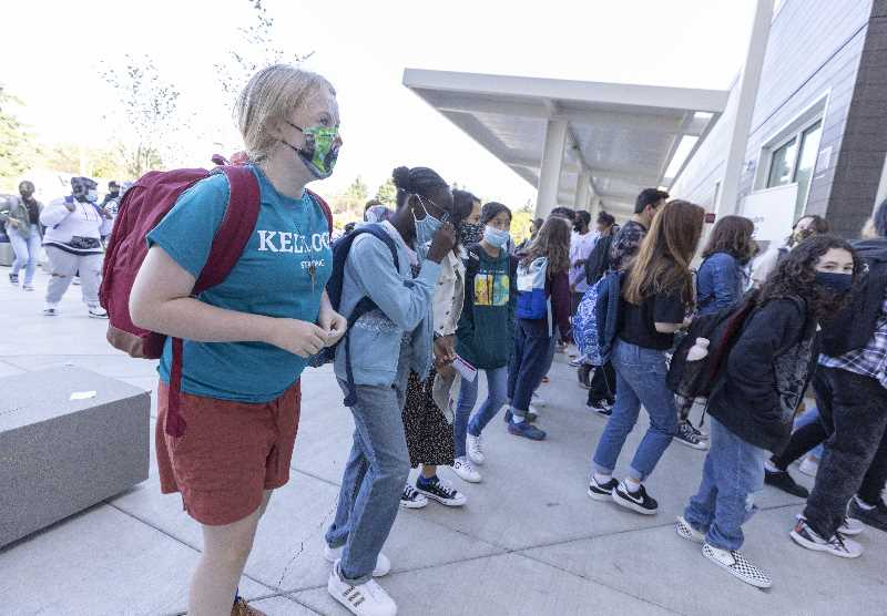 PMG PHOTO: JONATHAN HOUSE - Students arrive at Kellogg Middle School for the first day back on Sept. 1 in Portland. Since school started, thousands of students and staff across Multnomah County have had to quarantine due to contracting or being exposed to someone with COVID-19