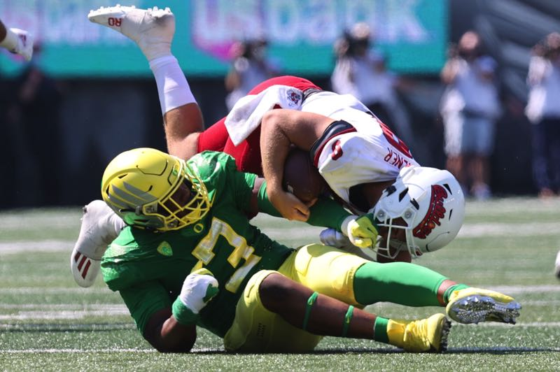 PMG PHOTO: JAIME VALDEZ - Defensive talent such as sophomore defensive tackle Brandon Dorlus, pictured sacking Fresno State quarterback Jake Haener, is one reason the Oregon Ducks are the Pac-12s team to beat.