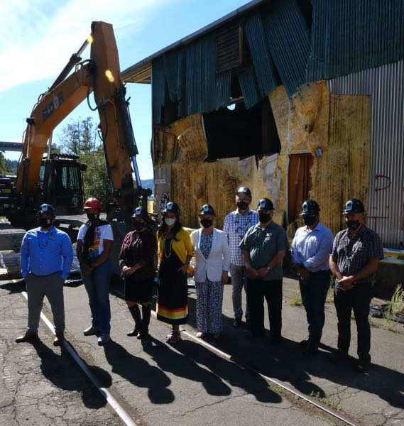 PMG PHOTO: JAELEN OGADHOH - Members of the Oregon City Commission pose alongside members of the Grand Ronde Tribal Council in front of the demolition site.