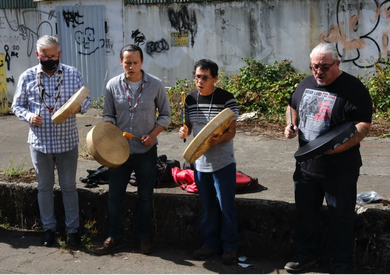 PMG PHOTO: JAELEN OGADHOH - Tribal leaders from the Confederated Tribes of Grand Ronde conduct a ceremonial performance with drumming and singing prior to building demolition at Willamette Falls.