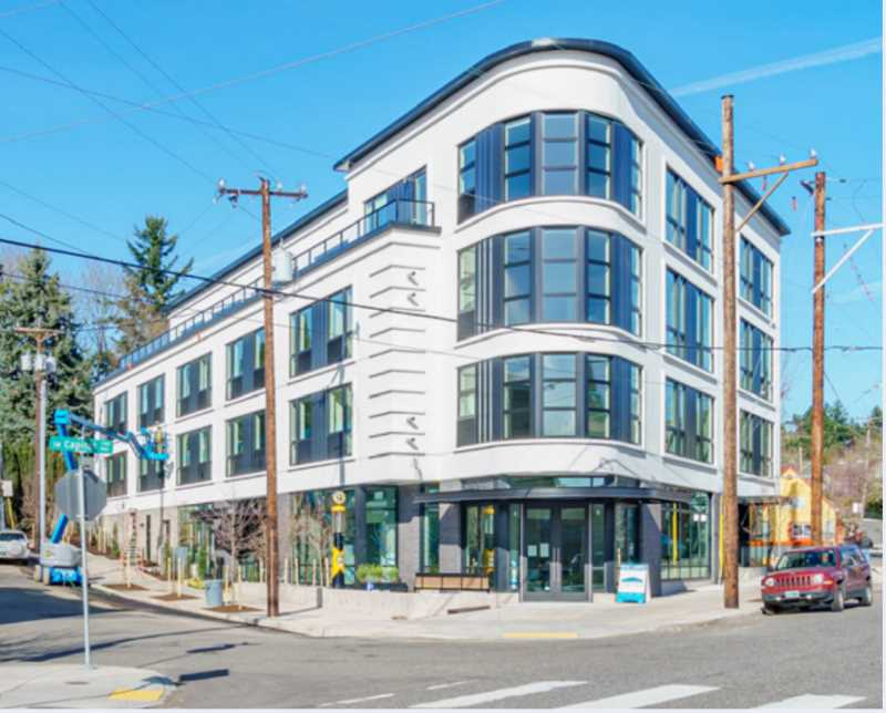 COURTESY PHOTO: PORTLAND PLANNING AND SUSTAINABILITY COMMISSION - Multnomah Station, an apartment complex on Southwest Capitol Highway, showcases the type of development within shopping and walking districts that Southwest Portland could see much more of in the future.