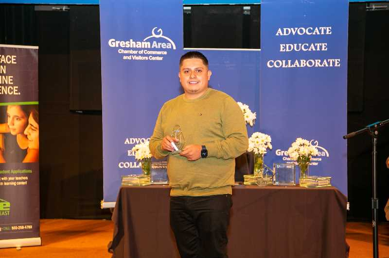 COURTESY PHOTO: GRESHAM AREA CHAMBER OF COMMERCE AND VISITORS CENTERS - Rudy Loeza accepting the Gresham Area Chamber of Commerces Rising Star Award.