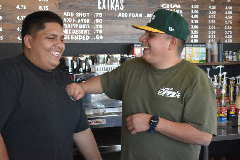 PMG PHOTO: ANGEL ROSAS  - Loeza and his brother Manny Loeza joking around before they close up shop for the day. Loeza credits the coffee shop's success to his family who devoted their time and energy to making his dream a reality.