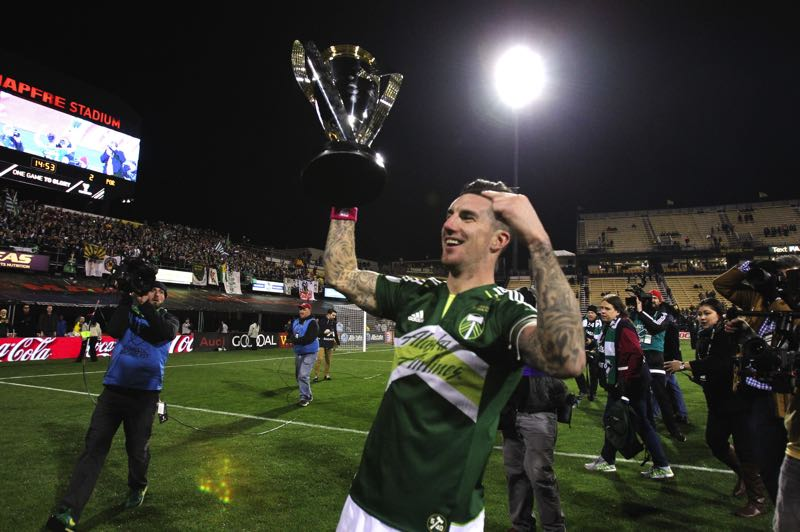 PMG PHOTO: JAIME VALDEZ - Liam Ridgewell lifts the MLS Cup trophy on Dec. 6, 2015 in Columbus, Ohio afterhelping lead the Portland Timbers to a 2-1 win over the Crew in the MLS Cup final. Ridgewell is returning to join the Timbers broadcast team.