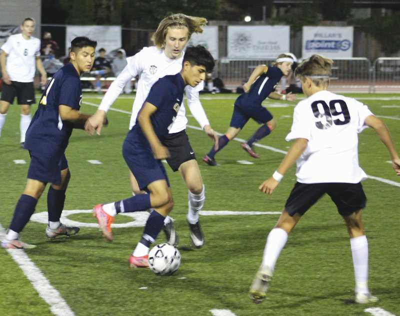 PMG PHOTO: KRISTEN WOHLERS - The Canby boys soccer team got into the win column Sept. 22 with a 2-1 win over Oregon City. All three goals came courtesy of penalty kicks.