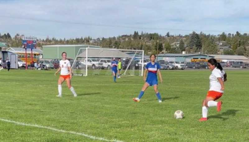 Molalla girls soccer team opened league play with a win over Madras.