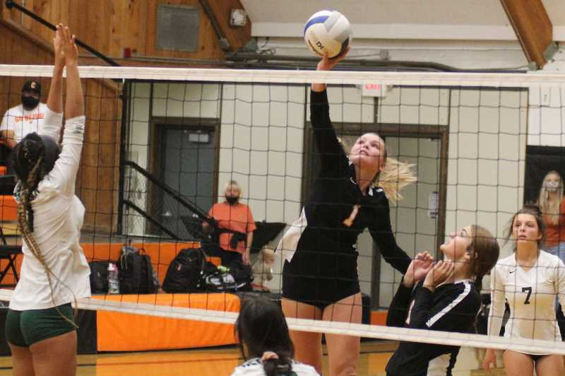 ANDY DIECKHOFF/MADRAS PIONEER - Culver senior Lucy Louden (1) led the Bulldogs in kills during Monday's home victory over Delphian.