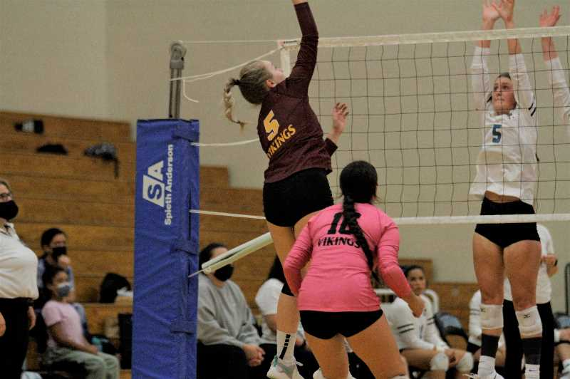 PMG PHOTO: WADE EVANSON - Forest Grove's Alli Klaus attacks the net during the Vikings' game with Century Wednesday, Sept. 22, at Century High School.