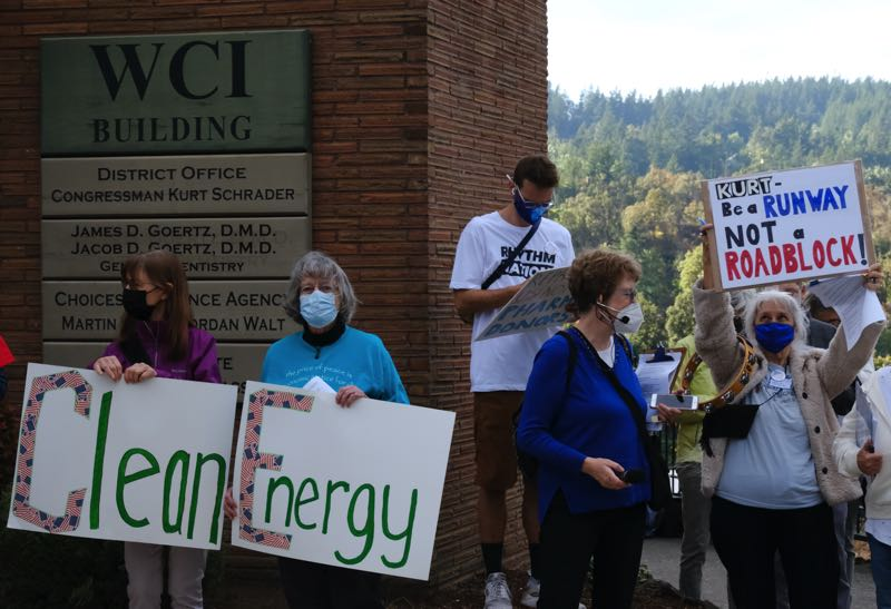 PMG PHOTO: JAELEN OGADHOH - Protesters gather in front of Rep. Kurt Schrader's Oregon City district office.
