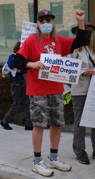 PMG PHOTO: JAELEN OGADHOH - A protester representing Health Care for All Oregon speaks at the Sept. 22 protest.