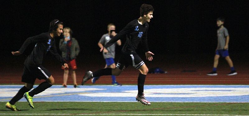 PMG PHOTO: MILES VANCE - Lakeridge senior forward Zac Levin takes flight after scoring his second goal during the Pacers' 5-0 win over Lake Oswego at Lakeridge High School on Wednesday, Sept. 22.