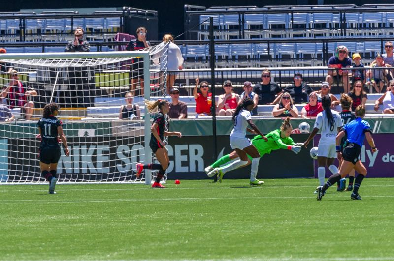 PMG PHOTO: DIEGO G. DIAZ - Diving for a loose ball, Bella Bixby denies NJ/NY Gotham FC a scoring chance in a July 11 game at Providence Park.
