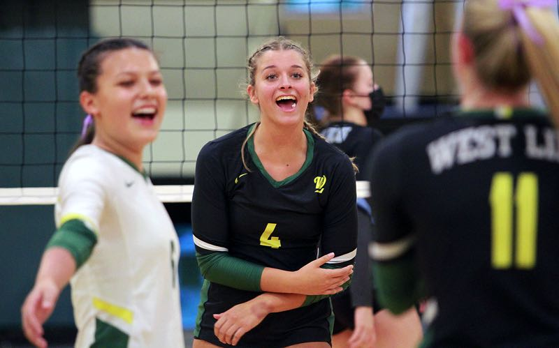 PMG PHOTO: MILES VANCE - West Linn senior Ella Nordquist celebrates a point with her team during its 3-0 win over Lakeridge at West Linn High School on Thursday, Sept. 23.