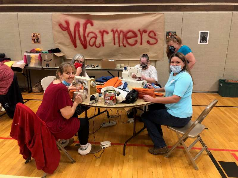 COURTESY PHOTO: JILL NEWSOM - Volunteers made 95 sets of hand and neck warmers to be shared with the Cover Up program, which provides needed items to veterans and their families.