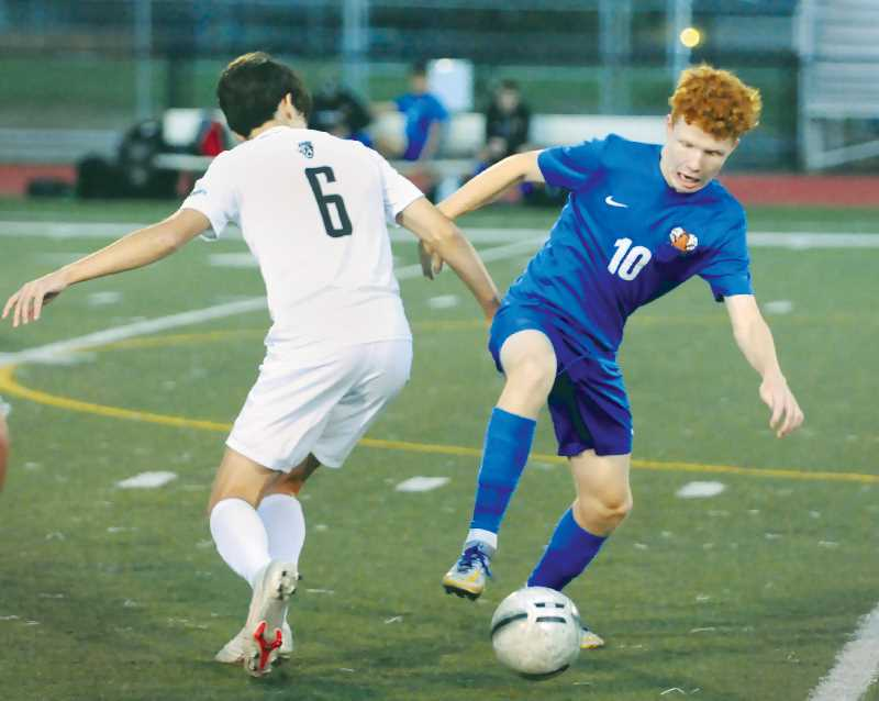 PMG PHOTO: GARY ALLEN - With its non-league schedule nearing its conclusion, the Newberg High School boys soccer team is 4-2 and ranked No. 22 in the state by the OSAA. Included in the Tigers' strong showing early in the season was a three-game winning streak with a wide scoring margin.