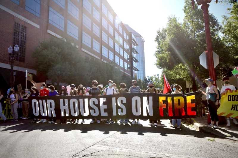 PMG PHOTO: JAIME VALDEZ - Students march while holding a banner that reads, 'Our house is on fire' during a climate strike that saw hundreds of students leave class to march and rally in downtown Portland.