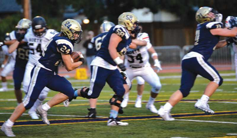 PMG PHOTO: SARAH OLIVER - Canby running back Tyler Konold cracked the 200-yard rushing barrier in Friday's 55-13 win over St. Helens.
