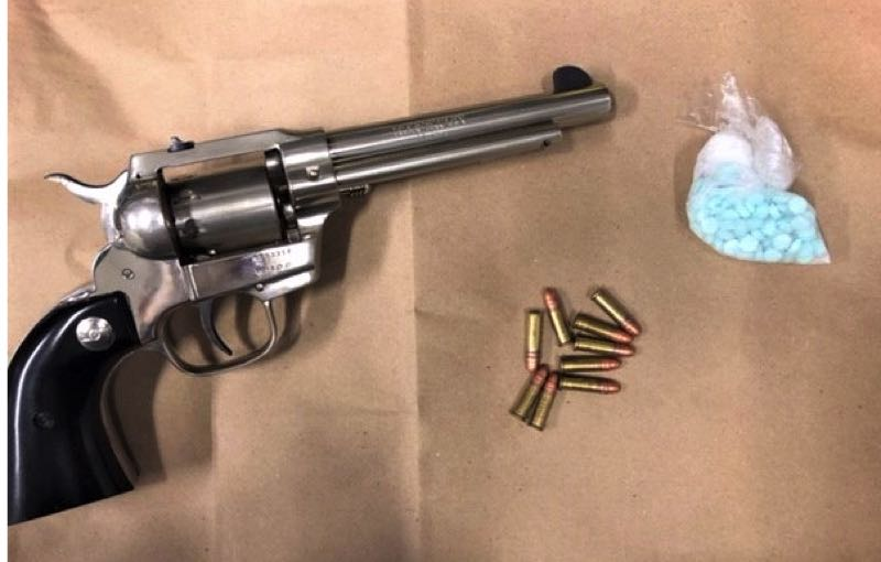 COURTESY PHOTO: PPB - A silver revolver with black handle, unspent ammunition, and a baggie of blue pills were seized by Portland police.